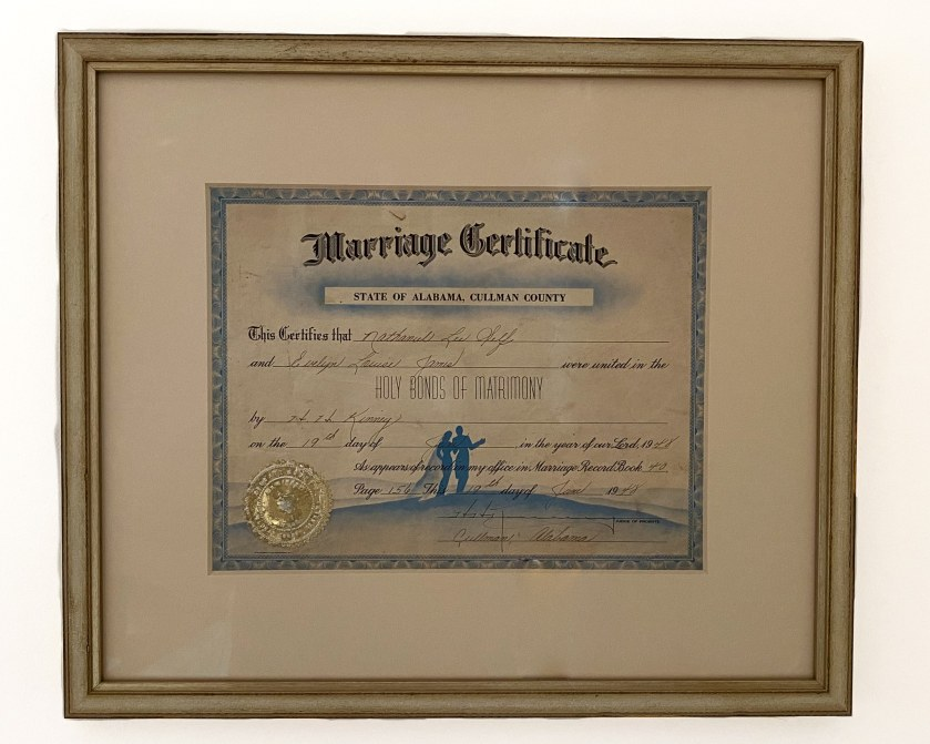 The finished product of a restored wedding certificate. It is framed and matted.