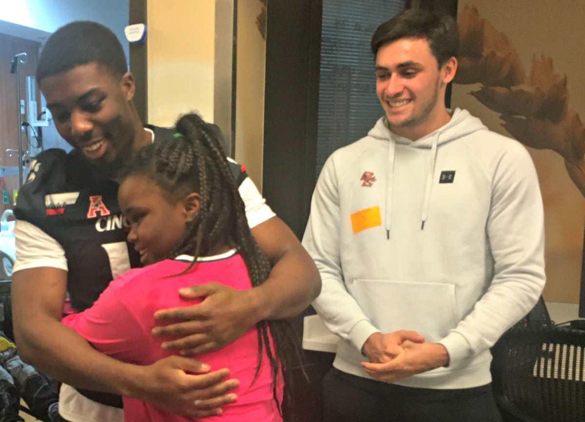 Football players and Children's of Alabama patient