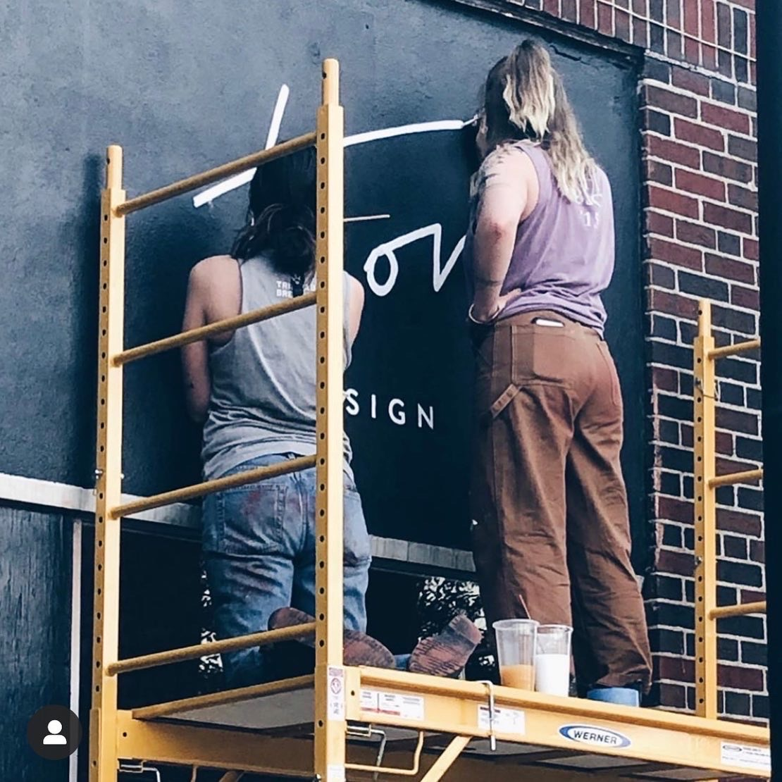 bendyknees design company painting signs at Trove
