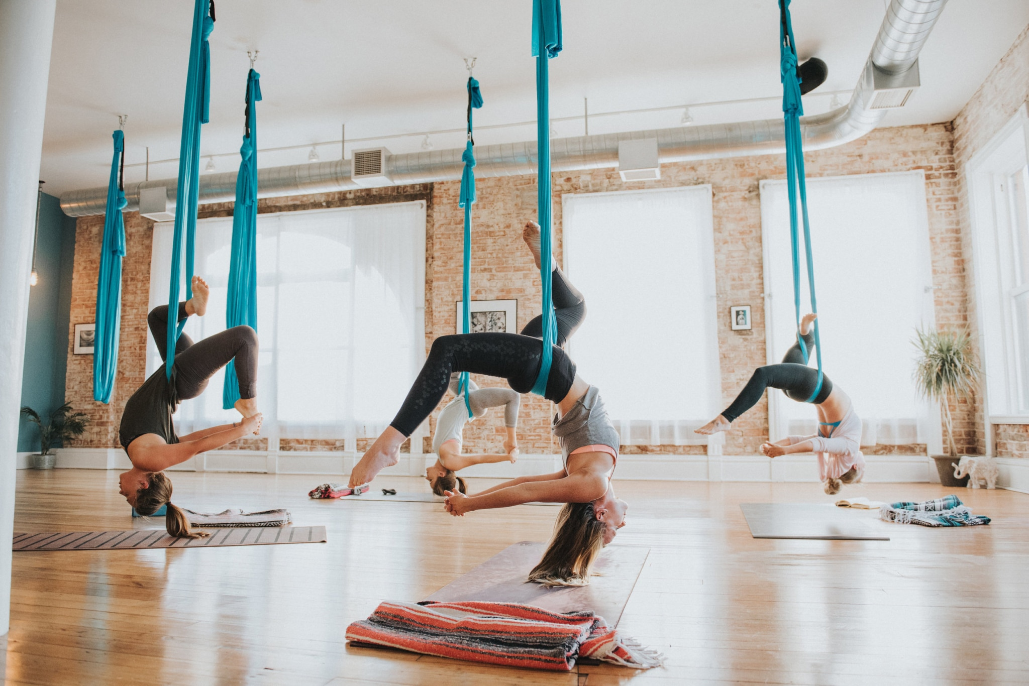 Jazz up your workout routine with these 4 aerial yoga ...