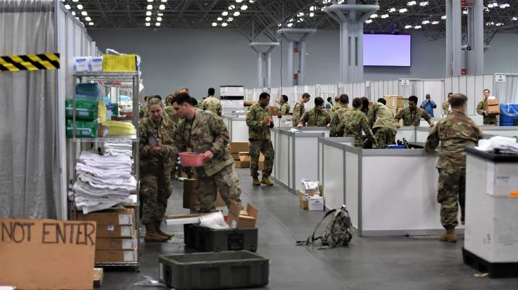 soldiers working on setting up the temporary field hospital at the Javits Center in NYC for COVID-19