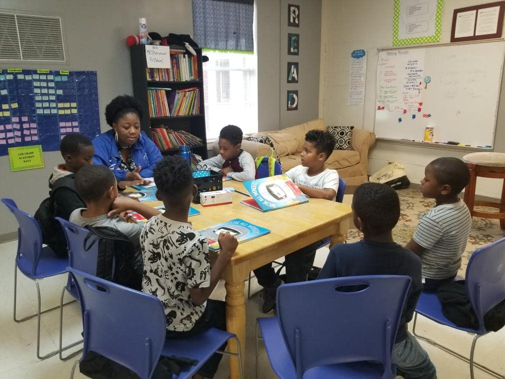 Children learning to love reading at I See Me, Inc.