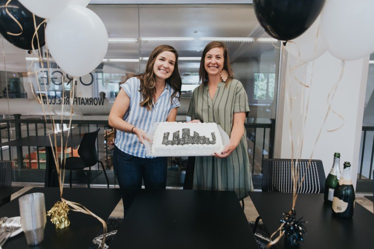 Kelsey + Kim with a Forge birthday cake, back when people could stand close to each other