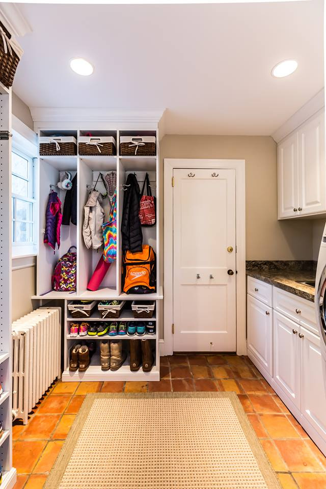 an organized mudroom where kids and family members can put all their things