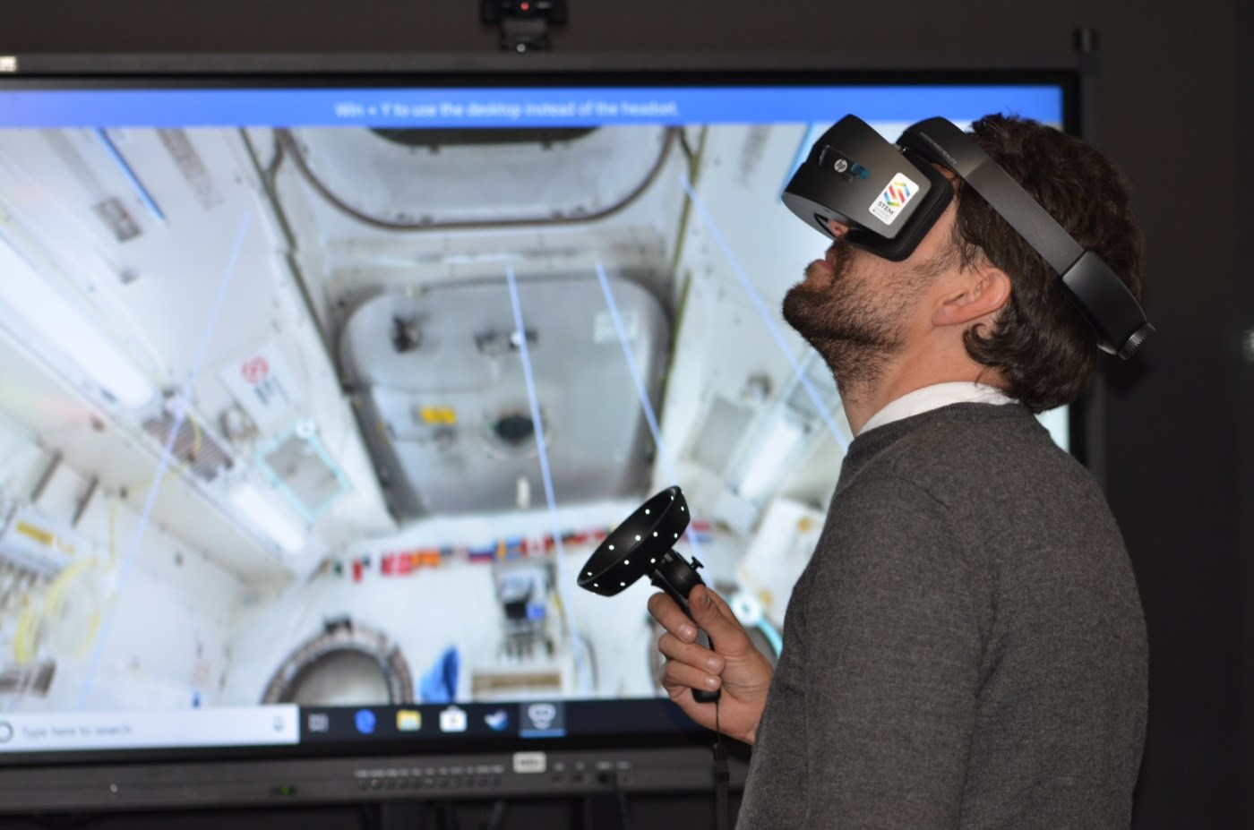 man playing VR goggles