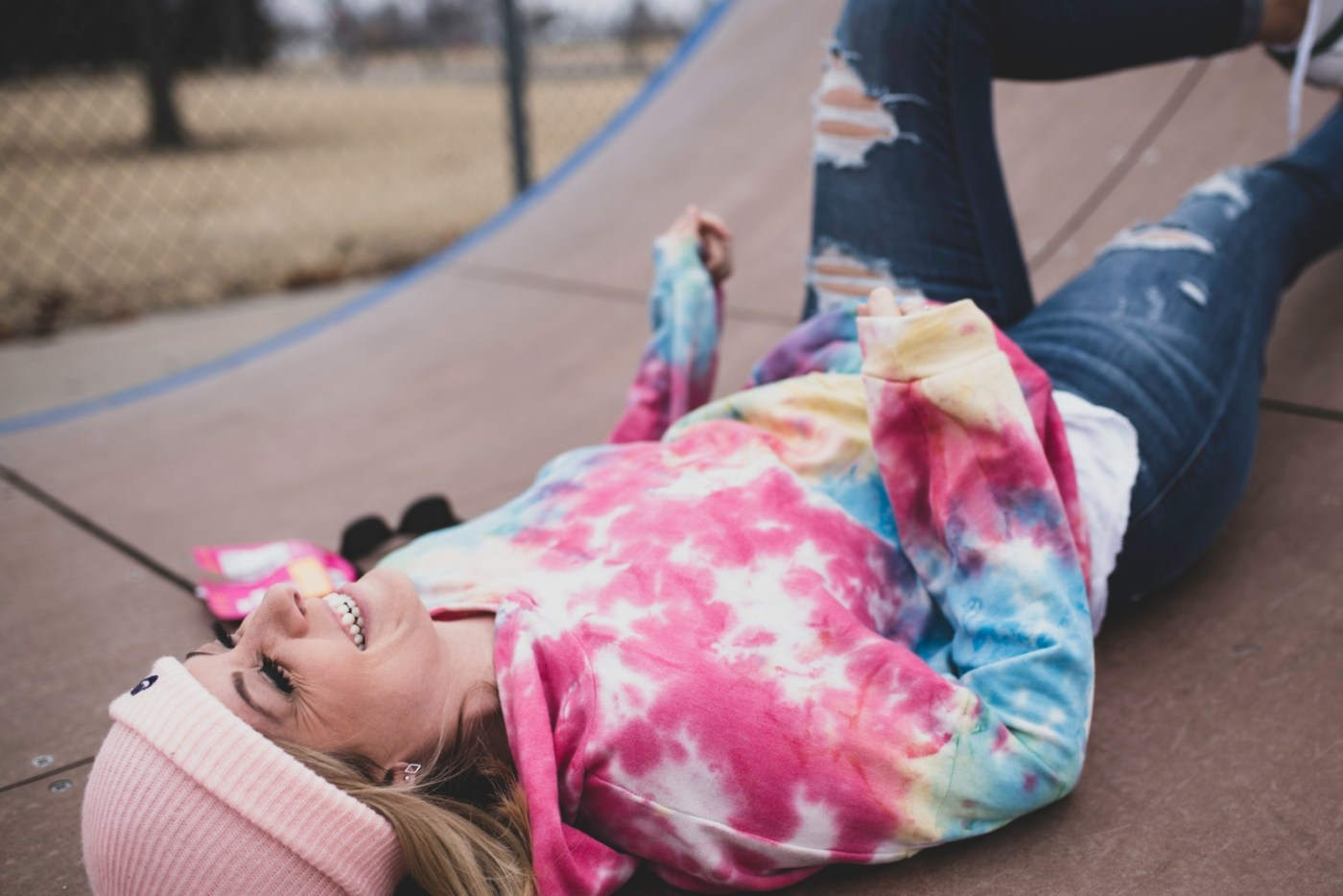 girl in pink and white striped long sleeve shirt lying on ground