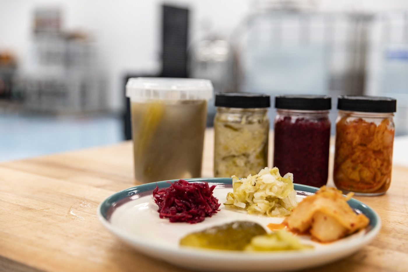 A sampling of Harvest Roots incredible ferments, including jalepeno pickles, dill pickle sauerkraut and kimchi