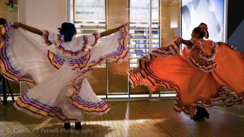 Photo of Latina dancers in traditional dresses