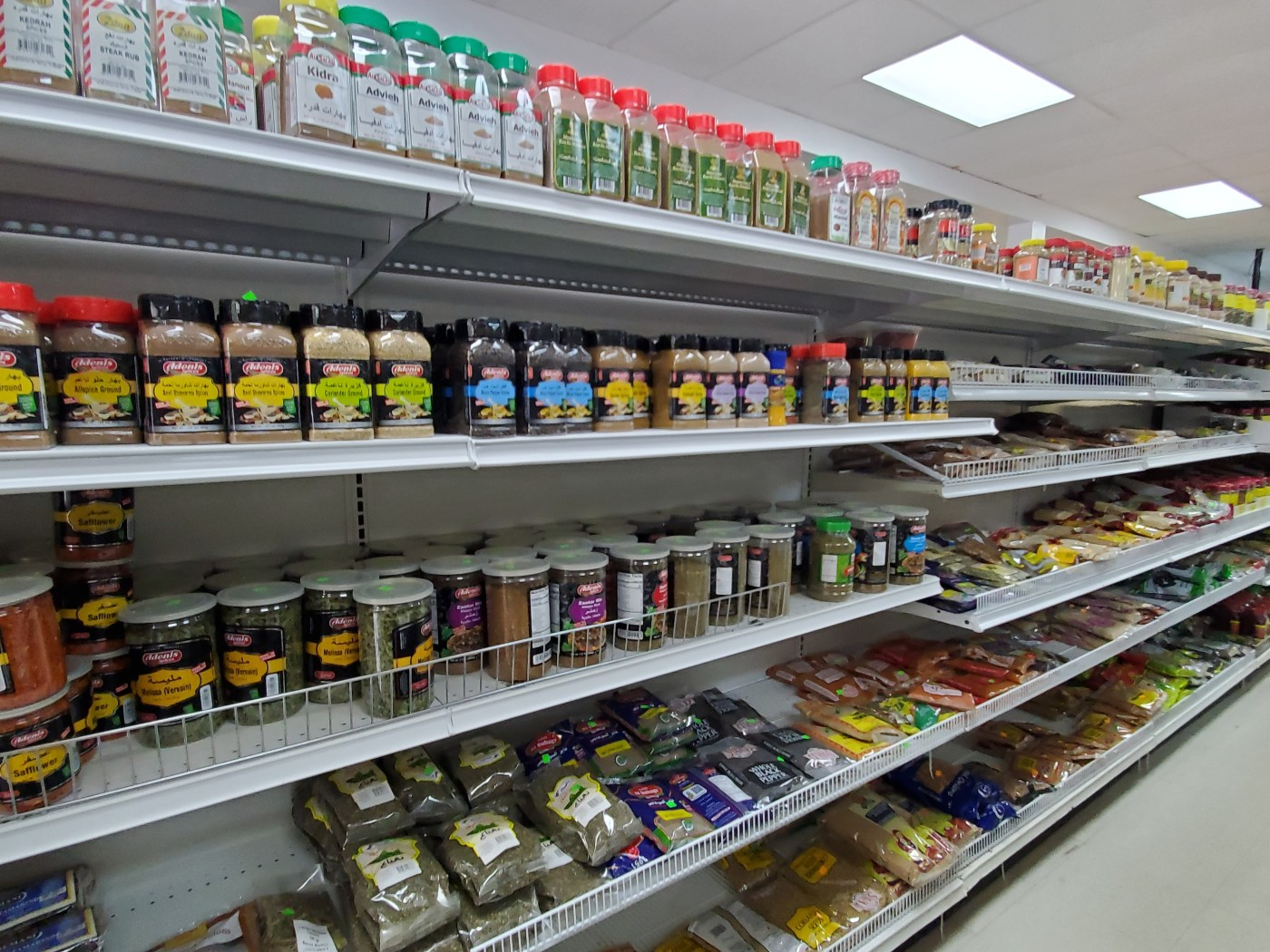A photo of the spice shelves at Halal Supermarket