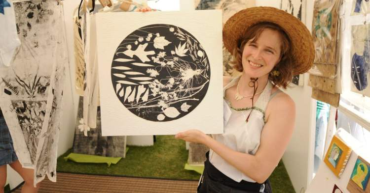 local artist holds painting at Magic City Art Connection's MOSS MAGIC event