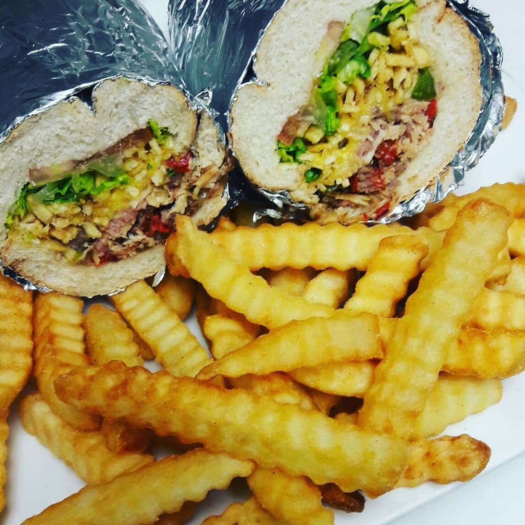 Photo of Miami Fusion Cafe's sandwich with fries