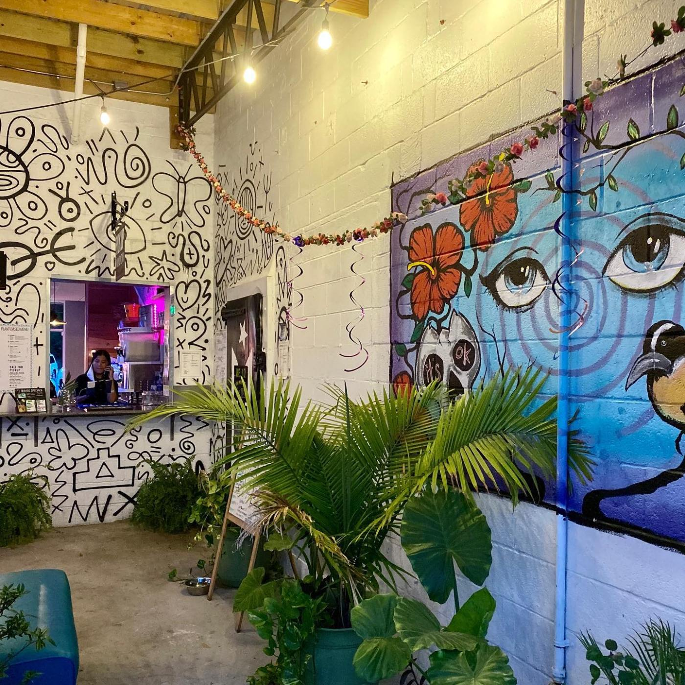 Different murals on Tropicaleo's patio outside
