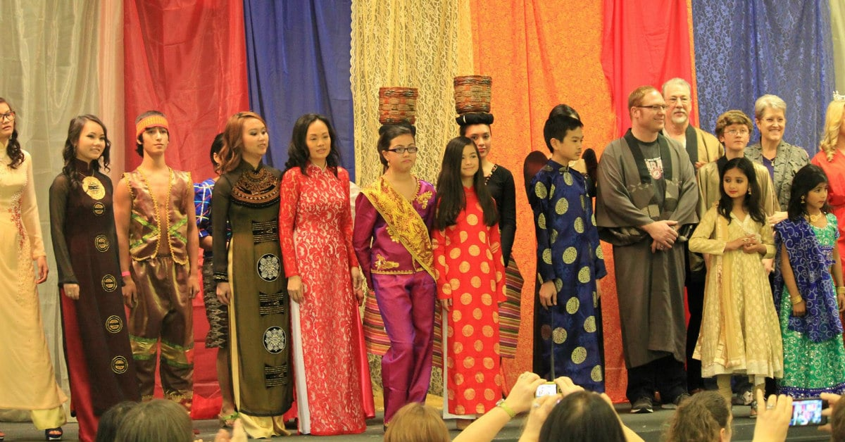 people wearing beautiful dresses from Asian at an Alabama Asian Cultures Foundation event