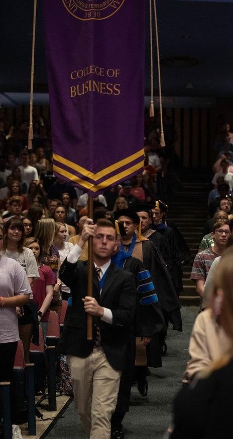 People at a graduation ceremony at UNA