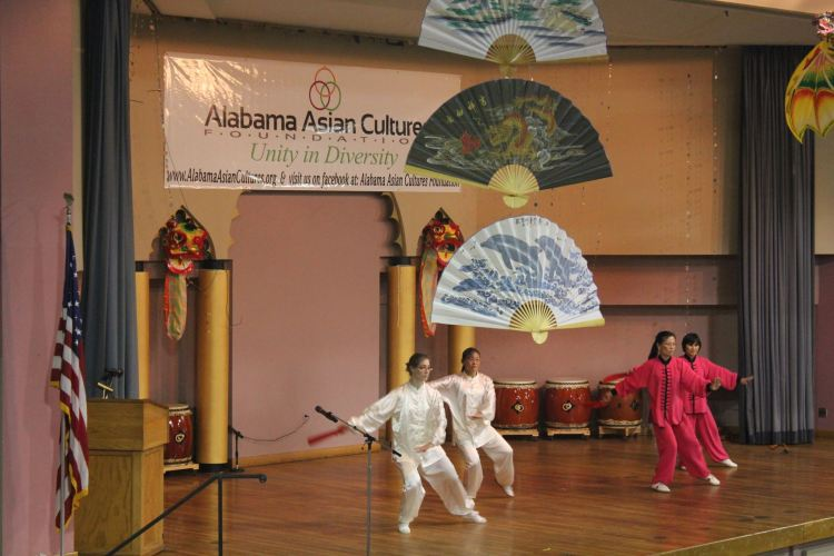 Dancers on a stage at an AACF event