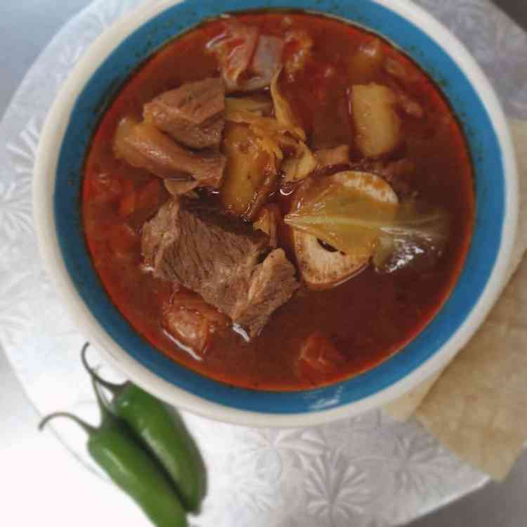 Beef soup with a side of jalapeno at Gordo's