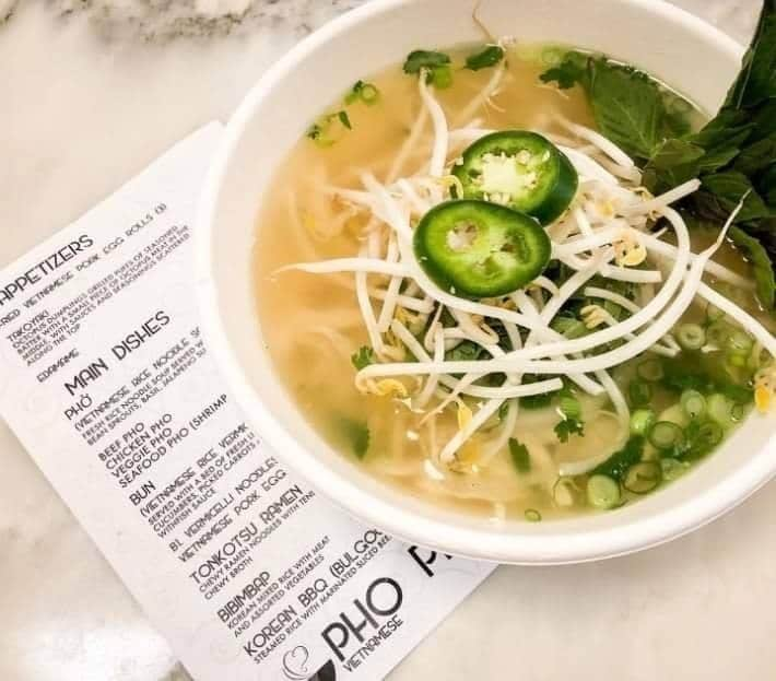 Rice noodle soup with different toppings from Pho Pho