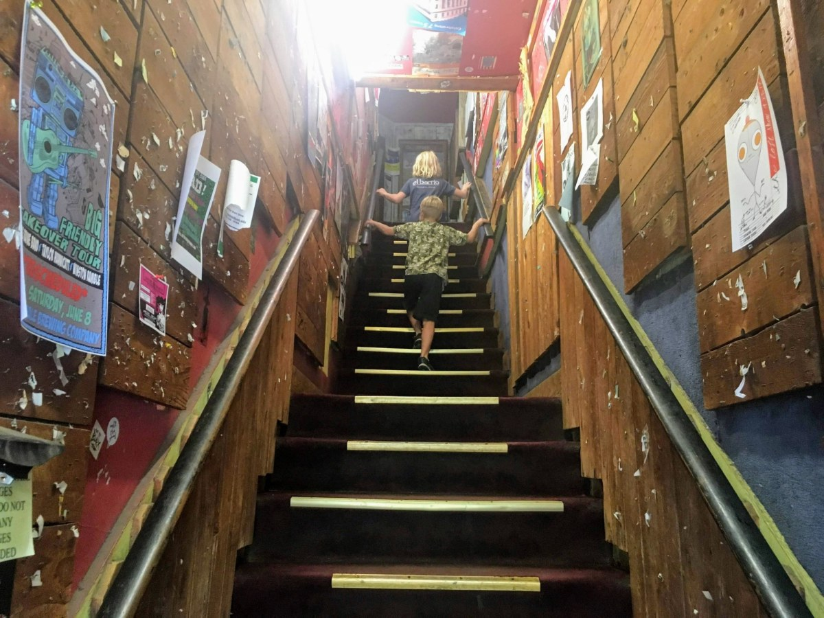 kids walking up stairs at Charlemagne Record Exchange