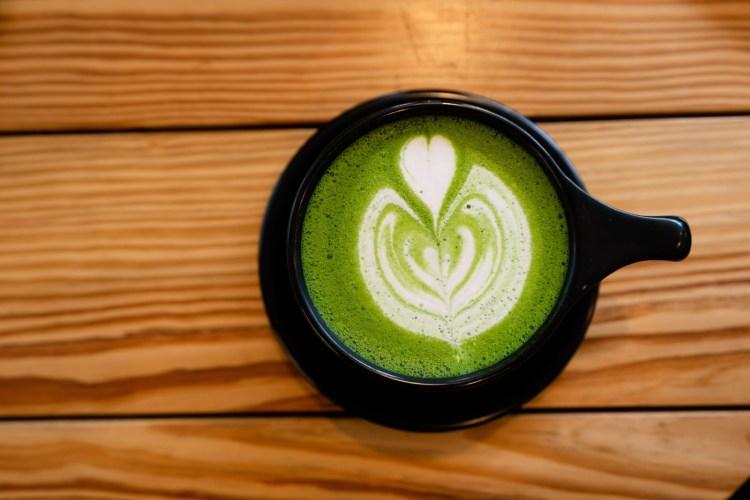 latte on black ceramic mug
