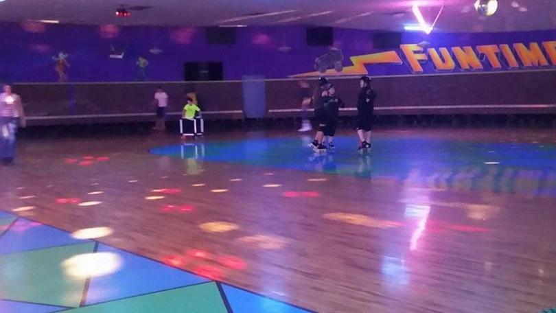 Neon lights over wooden skating rink at Funtime Skate Center