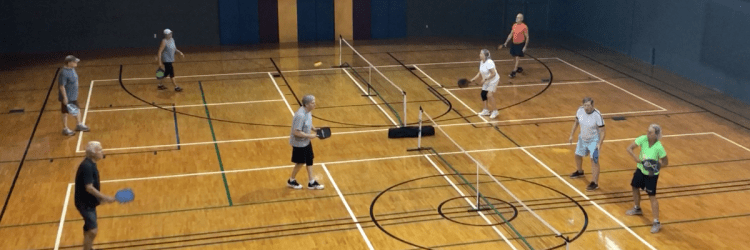 Wooden courts with adults playing pickleball at Levite Jewish Community Center - Birmingham sports leagues