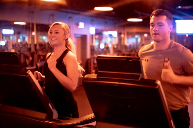 Orangetheory love, couple running, two people running on treadmills