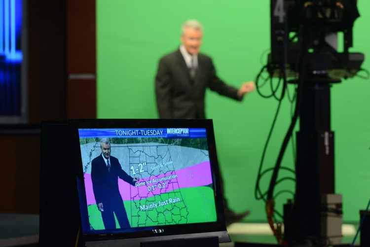 Jerry Tracy of WVTM 13 in front of a green screen