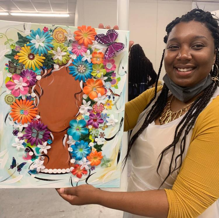 Sips n Stroke student holds up mixed media creation art classes in Birmingham