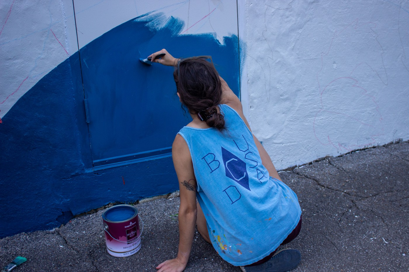 Mary Grace Tracy is working on the mural at Sozo. Photo by Libby Foster for Bham Now.