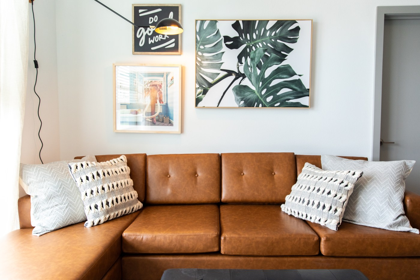 Lumen Above Railroad Park couch in living room