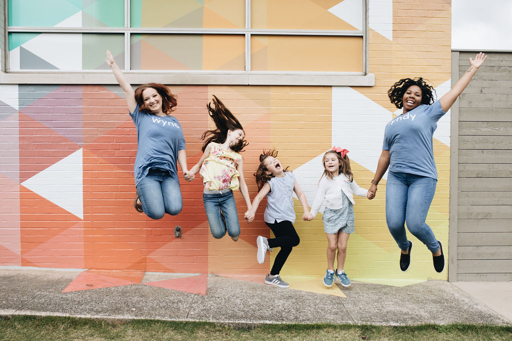 I'm jumping for joy because Birmingham businesses are growing. Photo via Wyndy