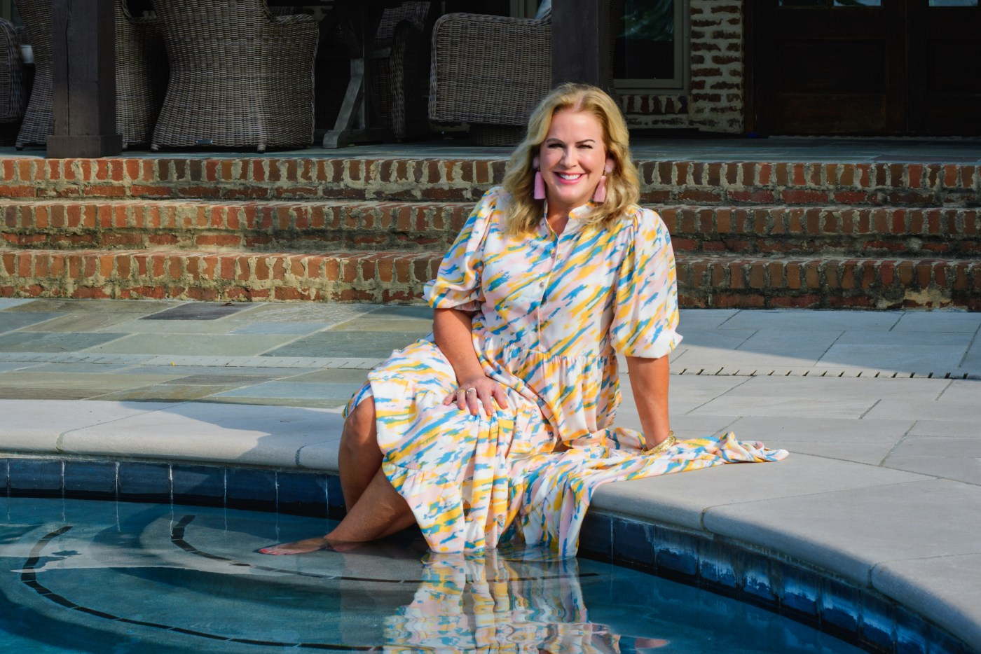 woman at pool, outdoor living