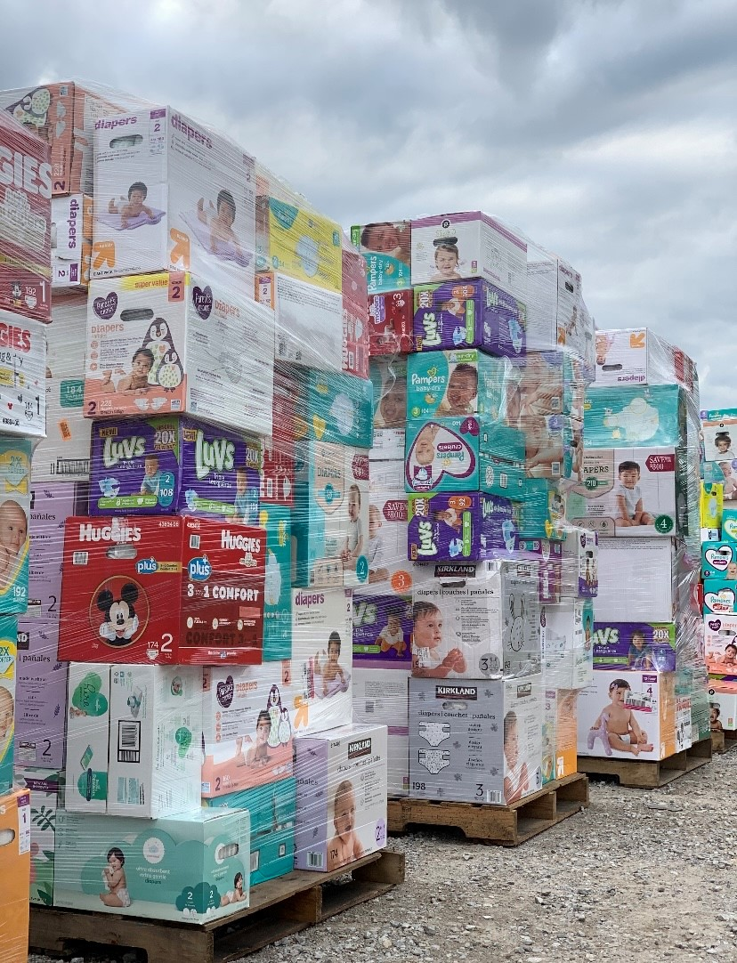 palettes full of diaper boxes
