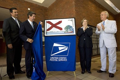 Officials unveiling the Alabama stamp are (left to right) Birmingham Postmaster Samuel Jaudon, Gov. Bob Riley, Montgomery Postmaster Teresa Welch, and Lee Sentell, director of Alabama Tourism. Courtesy - State of Alabama (Governor's Office)