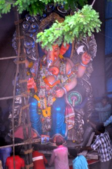 A ganpati idol being prepared for the visarjan earlier in the day