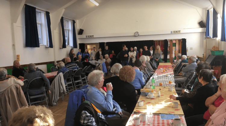Talking at Hove Food and Friendship Lunch