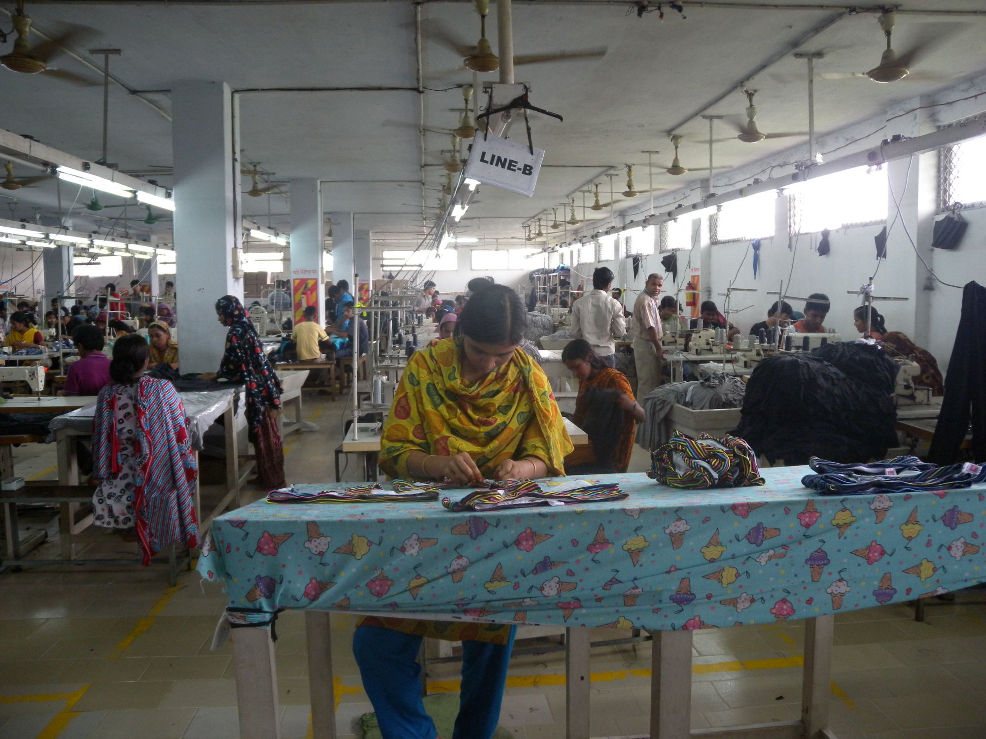 Who made your clothes? This image shows a garment factory in Bangladesh. The Rana Plaza garment factory in Bangladesh's capital Dhaka collapsed in 2013, killing more than a thousand workers. Photo CC-BY Tareq Salahuddin (source) https://www.flickr.com/photos/91431624@N00/5904028188