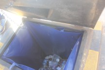 Rubbish in an opened underground bin