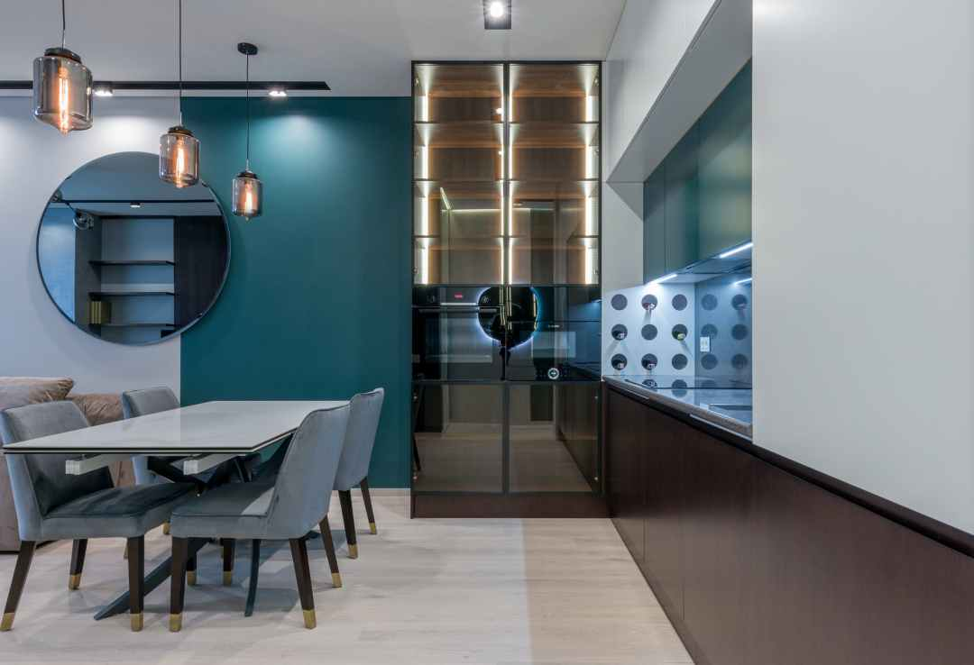 interior contemporary dining room with glass cupboard and table with chairs