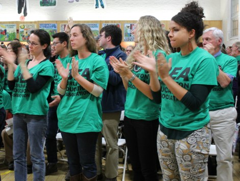 Teachers applaud a speaker during the public comment period at the Burlington School District meeting on Thursday, Oct. 13.