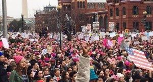 A woman raises her first in the air as thousands of people gather for the Women's March on Washington on Jan. 21. The event took place the day after the Inauguration.   Photo: Emma Chaffee/ Register