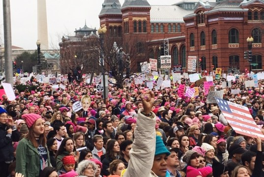A woman raises her first in the air as thousands of people gather for the Women's March on Washington on Jan. 21. The event took place the day after the Inauguration. | Photo: Emma Chaffee/ Register