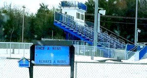 """A sign outside the South Burlington High School football field reads """"Once a Rebel, Always a Rebel,"""" pictured on Feb. 8. The school board voted unanimously to remove the mascot, as ties to the confederate south prompted pressure from students and community members. 