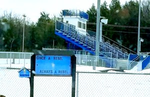 "A sign outside the South Burlington High School football field reads ""Once a Rebel, Always a Rebel,"" pictured on Feb. 8. The school board voted unanimously to remove the mascot, as ties to the confederate south prompted pressure from students and community members. 