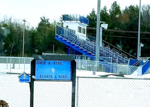 A sign outside the South Burlington High School football field reads
