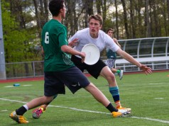 Burlington High School senior Matt Boisvert wrestles for the Frisbee in a game against Vermont Commons School in April 2016. | Photo: Jake Bucci/Register