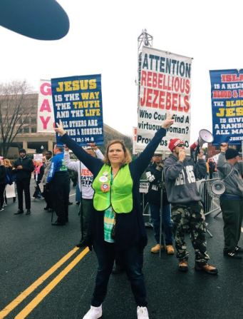 A women stands in front of protesters of the march. Photo: Emma Chaffee/Register
