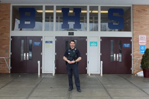 School Resource Officer Brian Difranco stands outside the entrance to the high school on March, 28. | Photo: Alexandre Silberman/Register