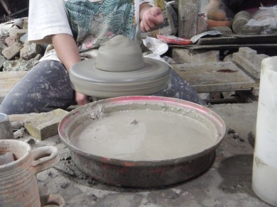 Ate demonstrating on how to do the pots.