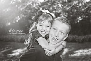 Brother giving little sister piggyback ride